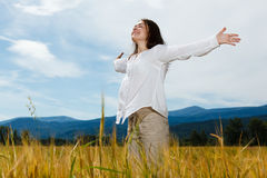 Girl holding arms up Royalty Free Stock Photos