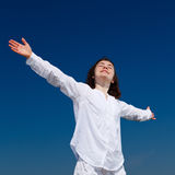 Girl holding arms up Stock Photos