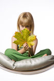 Girl holding a autumn maple leaf Stock Photos