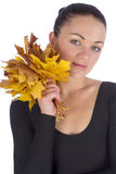 Girl holding autumn orange maple leaves on white. Background Stock Image