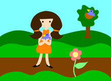 Girl holding baby blue bird. The girl on the walking path, holds a baby blue bird, near its nest in a tree Stock Photography