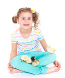 Girl holding baby chickens Royalty Free Stock Image