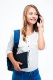 Girl holding backpack and book Stock Photography