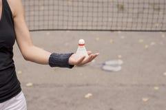 Girl holding a badminton shuttlecock Royalty Free Stock Photo