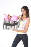 Girl holding bag of pink balloon Stock Photo