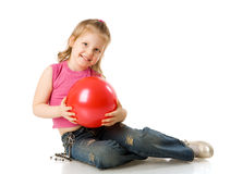 Girl holding ball Royalty Free Stock Photo
