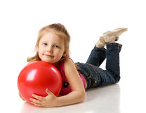 Girl holding ball Stock Photos