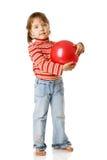 Girl holding ball Stock Photos