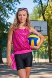 Girl holding ball Stock Photography