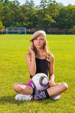 Girl holding ball Stock Images