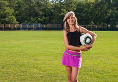 Girl holding ball Stock Photography