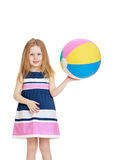Girl holding a ball Royalty Free Stock Image