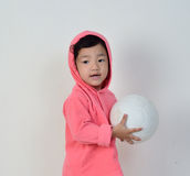 Girl is holding the ball. Royalty Free Stock Photo