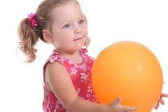Girl holding a balloon Stock Photos