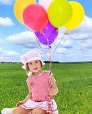 Girl holding balloons royalty free stock image