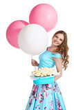 Girl holding balloons, box with flowers and smiling Stock Photo