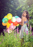 Girl holding balloons in hand Royalty Free Stock Photos