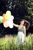 Girl holding balloons in hand Royalty Free Stock Images