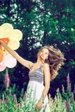 Girl holding balloons in hand Royalty Free Stock Photography