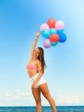 Girl holding balloons sky background Stock Image