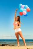 Girl holding balloons sky background Stock Photos