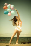 Girl holding balloons sky background Royalty Free Stock Photo