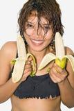 Girl holding a banana. Happy girl holding a banana Royalty Free Stock Images