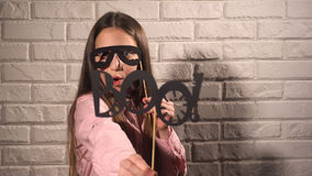 Girl holding a banner with black glasses Stock Images