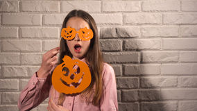 Girl holding a banners with pumpkins Royalty Free Stock Images