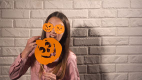 Girl holding a banners with pumpkins Royalty Free Stock Photo