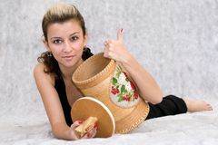 Girl Holding a Barrel Royalty Free Stock Image