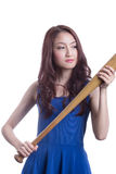 Girl holding a baseball bat. Royalty Free Stock Photography