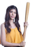 Girl holding a baseball bat. Royalty Free Stock Image