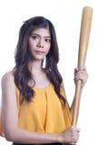 Girl holding a baseball bat. Royalty Free Stock Image