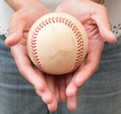 A Girl Holding Baseball in Two Hand stock photo