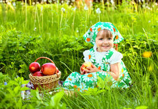 Girl holding a basket of apples Royalty Free Stock Images
