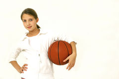 Girl holding basket ball Stock Image