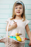 Girl holding a basket Royalty Free Stock Image