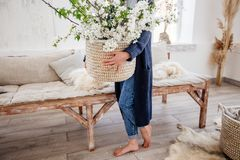 Basket with flowers in hands. stock photography
