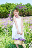 Girl holding basket with flowers Stock Photos