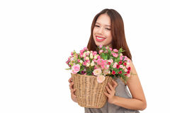 Girl holding a basket of flowers. Stock Photos