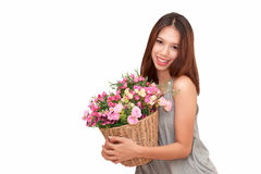 Girl holding a basket of flowers. Royalty Free Stock Images