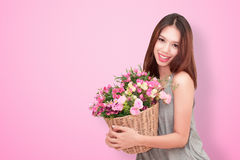Girl holding a basket of flowers. Stock Photography