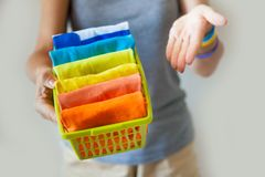 The girl is holding a basket with folded clothes. Keeping things Royalty Free Stock Image