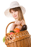 Girl holding a basket of  fresh vegetables. Stock Photos
