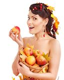 Girl  holding basket with fruit. Royalty Free Stock Photo