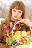 Girl holding basket with fruits and flowers Royalty Free Stock Photos