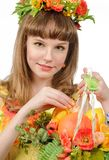 Girl holding basket with fruits and flowers Royalty Free Stock Photo