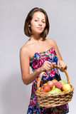 Girl holding basket full of fruit Royalty Free Stock Photography