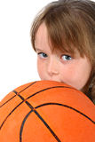 Girl holding basketball isolated on white Stock Photography